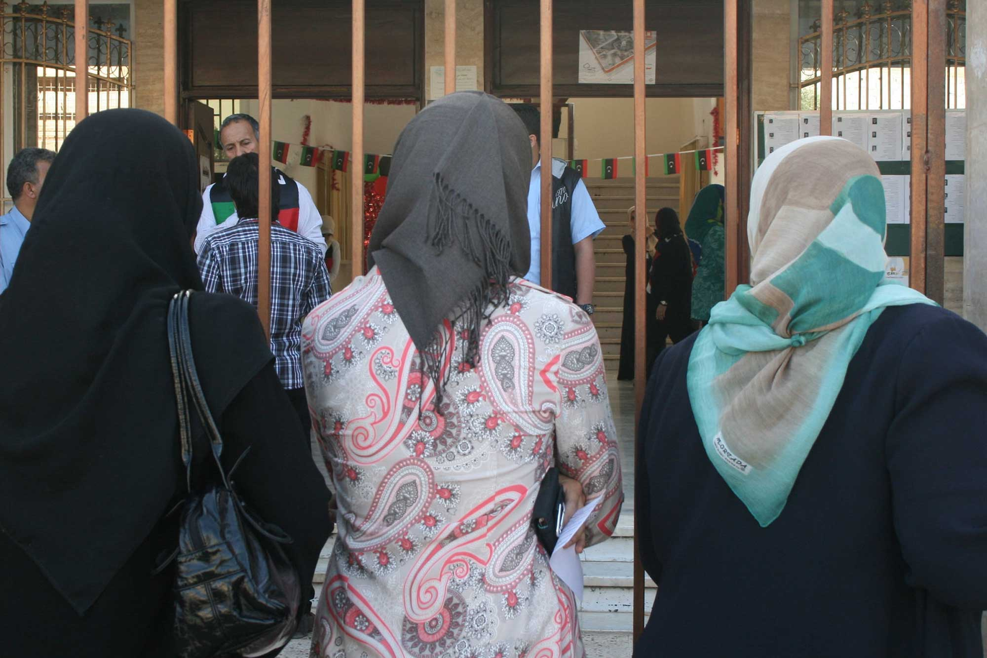 women look through gate